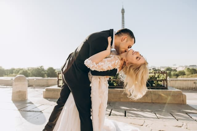 groom-kissing-bride-neck