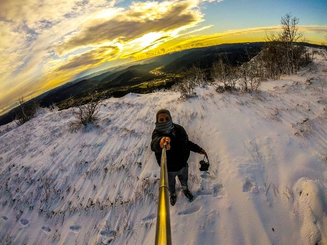 man-standing-on-snowy-terrain