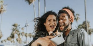 photo-of-man-and-woman-taking-selfie