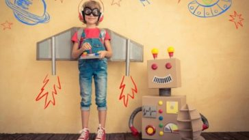 photo-child-playing-and-learning-with-robot